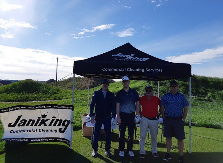Golfers standing under tent