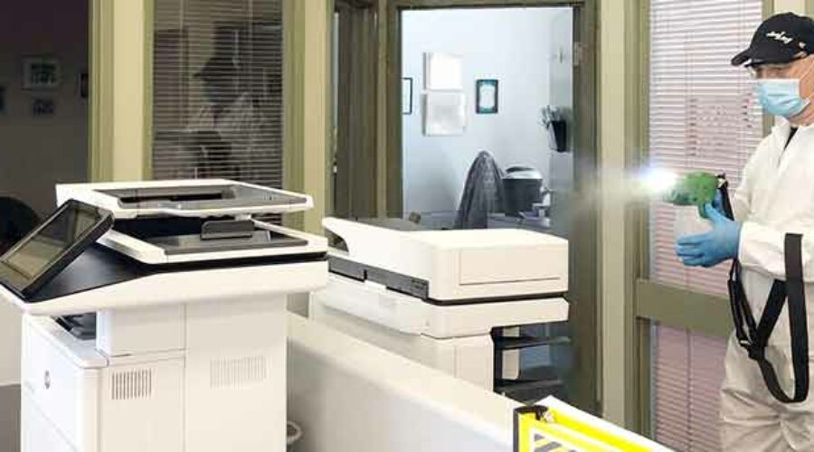 Jani-King franchisee using electrostatic sprayer to disinfect office
